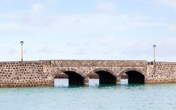 Arrecife Bridge on the Spanish island of Lanzarote. A stone bridge in the port city of Arrecife on the Spanish island of Lanzarote Stock Photo