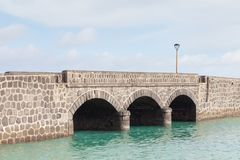 Arrecife Bridge on the Spanish island of Lanzarote. A stone bridge in the port city of Arrecife on the Spanish island of Lanzarote Royalty Free Stock Photo