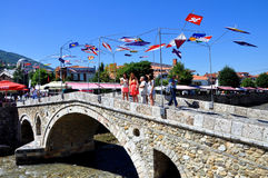 Stone Bridge in Prizren. Metal construction with flags of the participants in the Dokufest at Stone Bridge in Prizren Stock Photos