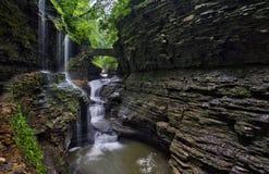 Stone bridge at Rainbow Falls in Watkins Glen State Park Royalty Free Stock Image