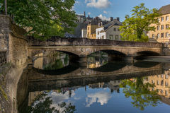 Stone bridge reflecting in the Alzette - 1 Royalty Free Stock Photos