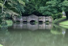 Stone Bridge Reflections in Buckingham, England, Stock Photography