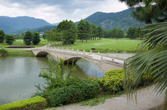 Stone bridge on a river Royalty Free Stock Images