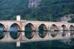 Stone bridge on river Drina, Bosnia. Old ottoman bridge over river Drina, Bosnia royalty free stock images