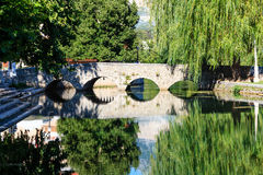 Stone Bridge, River and Willow Royalty Free Stock Photos