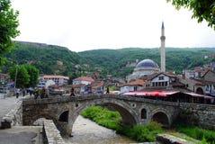Stone bridge and Sinan Pasha mosque. Prizren is a historic city located in Kosovo Stock Photo
