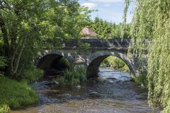 Stone bridge on a small stream in the French countryside.  stock photography