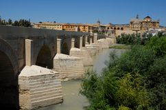 Stone bridge spanning the Guadalquivir in Cordoba in Spain Stock Photos