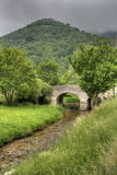 The stone bridge on the torrent Royalty Free Stock Photos