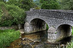The stone bridge on the torrent Royalty Free Stock Photography