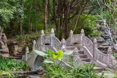 Stone bridge in a traditional garden. Stone bridge in a traditional Chinese style garden Stock Photo