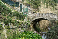 Stone bridge in the trail Royalty Free Stock Photography