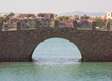Stone bridge in tropical resort Royalty Free Stock Images