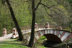 A stone bridge - Tsaritsyno park, Moscow, Russia. A twin colored bridge somewhere in Tsaritsyno park - Moscow, Russia stock images