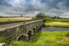 Stone bridge under moody sky. Stone bridge in newcastle co. Down north Ireland Royalty Free Stock Photo