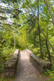 Stone Bridge Under the Trees. This is s stone bridge under a canopy of trees in Duluth, Minnesota Royalty Free Stock Images