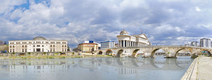 Stone bridge and Vardar river in Skopje, Macedonia. Beautiful old stone bridge and archaeological museum of Macedonia, Vardar river wather reflection Royalty Free Stock Photography