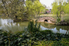 Stone bridge in verdant lake Stock Photos