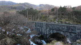 Stone bridge in Wales. Stone bridge in the mountains in Wales Stock Photography