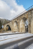 Stone bridge in winter, Ukraine. Rural view Royalty Free Stock Photos