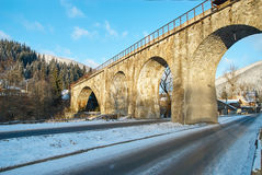Stone bridge in winter, Ukraine. Rural view Stock Photography