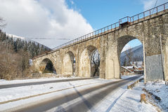 Stone bridge in winter, Ukraine. Rural view Stock Photos