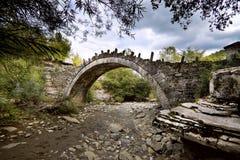 Stone bridge, Zagoria. Old stone bridge over dry valley in Epirus district, near village Kipi, Greece Royalty Free Stock Photo