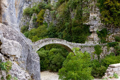 Stone bridge, Zagoria. Old stone bridge over dry valley in Epirus district, near village Kipi, Greece Stock Photography