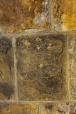 Stone brown surface old weather-beaten cracked vertical large blocks background urban stock photos
