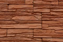 Stone brown texture from a fragment of a building wall Royalty Free Stock Photos