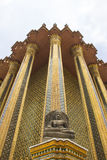 Stone Buddha in front of Thai architect in Emerald Buddha temple, Bangkok, Thailand Stock Photos