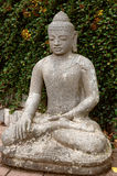 Stone Buddha in the lotus position. Stock Images
