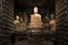 Stone Buddha and relics from Zhongshan Grottoes Xian, China. Stone Buddha and relics from the Zhongshan Grottoes in Zichang County displayed at the Shaanxi Stock Photos