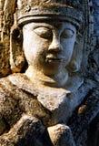 Stone buddha in relief. A stone Buddha statue on the external entrance to Shwezigon Paya pagoda in Bagan, Burma stock photography