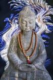 Stone Buddha statue, blue and white lights Royalty Free Stock Image