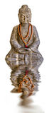 Stone Buddha statue and water reflection, isolated on white Stock Photography