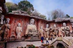 Stone Buddha on the stone wall at Wuxi Yuantouzhu - Taihu scenery garden, China. Stone Buddha on the stone wall at Wuxi Yuantouzhu - Taihu scenery garden, China stock photo