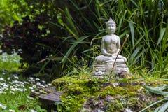 Stone buddha in a zen garden Royalty Free Stock Photography