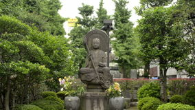 Stone Buddhaist statue Stock Image