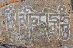 Stone with Buddhist mantras Stock Images