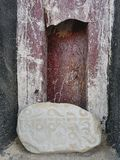Stone with Buddhist mantras in Sanskrit near the wall of a Tibetan monastery. Stock Photography