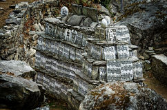 Stone with the Buddhist mantras,  way to Everest Base Camp in Hi Stock Images