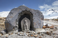 Stone Buddhist Statue in the Mountains Stock Photography