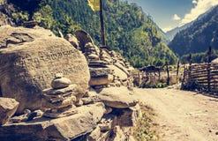 Stone with buddhist symbols. Stock Photography