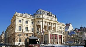 Stone building of bratislava national theatre. With the blue sky in winter royalty free stock image