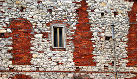 Stone building with brick repairs. This building is located in Piastra, a small village in the mountains above Carrara in Tuscany, Italy.  Repairs to the stone Royalty Free Stock Image
