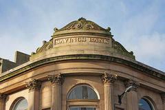 Savings bank. Stone building with carved words savings bank Royalty Free Stock Image