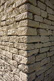 Stone Building At The Corner Of Sun And Shade Royalty Free Stock Photography
