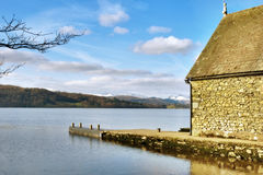 Stone building near the edge of a lake Stock Photography