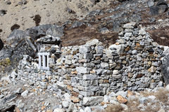 Stone Building under Construction in high altitude Village in Nepal. Handmade Stone Building under Construction made off natural peaces without using cement royalty free stock photo
